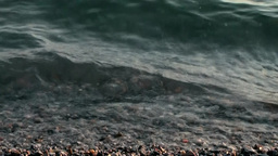 Turkey the Aegean Sea Bodrum 042 close up of water over pebble beach Footage
