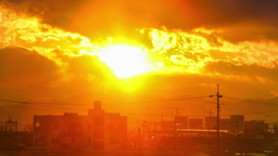 Beautiful sunset with large clouds and behind shining sun and eventually breakin Footage
