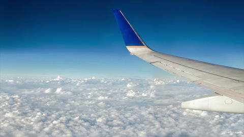Airplane Over Moving Clouds stock footage