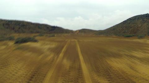 Driving Through Rough Desert Terrain stock footage