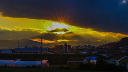 Beautiful Time Lapse Zoom Out Shot At Moving Sun With Clouds Behind Drammatic Sh stock footage