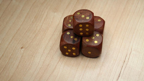 Wood Dice Cubes On Rotating Table Live Action