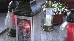 Votive lantern on the tomb. Candle snitch on the tombstone, the feast of the Image