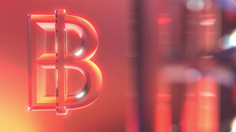 Rotating glass bitcoin symbols against red and orange background Footage