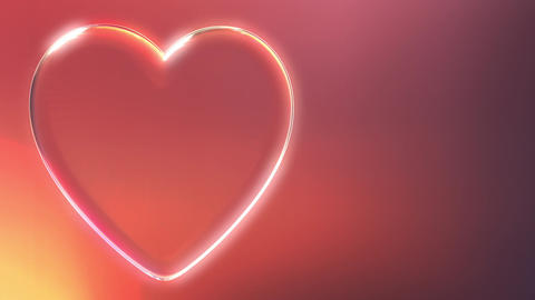 Rotating glass heart shape against red background Live Action