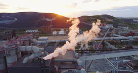 Aerial view Oil refinery with a background of mountains and sky at sunset Footage