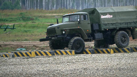 Slow motion shot of Russian military truck Ural moving through obstacles Footage