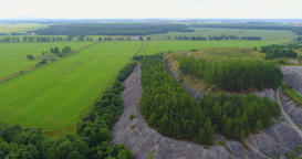 Aerial Drone Footage View: Flight over summer mountain with forests, fields Footage