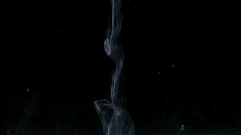 Macro of organic stream smoke falling down over a black abstract background Live Action
