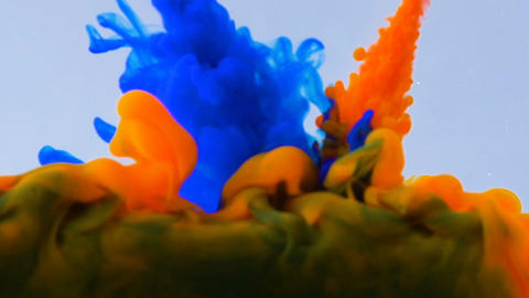Macro concept of multicolored inks falling and mixing in water abstract Footage