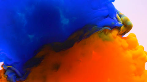 Colorful paint ink splashing and blending underwater Footage
