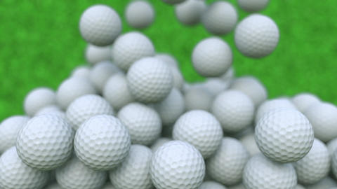 Multiple golf balls falling down, shallow focus Footage