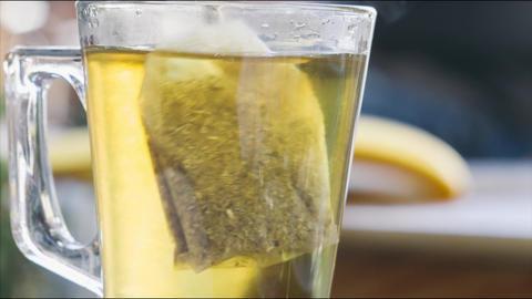 Stirring tea with honey close up 4K stock footage Image