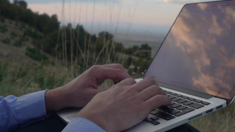 Businessman typing on laptop outside, apple computer, among nature, hacker, Footage
