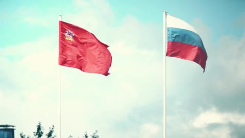 Waving flags of Russia and the Moscow Region. Slow motion shot Footage