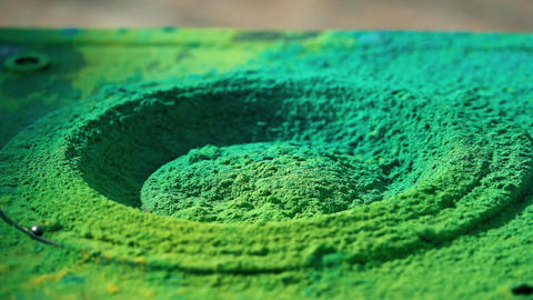 Loudspeaker throws colorful powder in the air, super slow motion shot Live Action