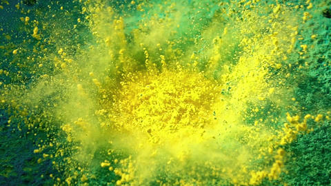 Loudspeaker throws yellow and green powder in the air Live Action