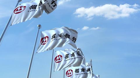 Waving flags with China Merchants Sbank logo against sky, seamless loop. 4K Footage