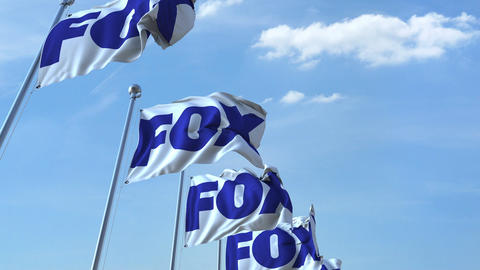 Waving flags with Fox logo against sky, seamless loop. 4K editorial animation Footage
