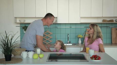 Happy family having breakfast in the morning Image
