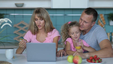 Joyful family shopping online with laptop at home Footage