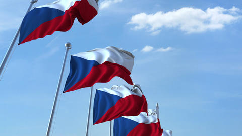 Row of waving flags of the Czech Republic agaist blue sky, seamless loop Footage