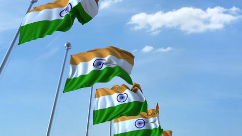 Row of waving flags of India agaist blue sky, seamless loop Footage