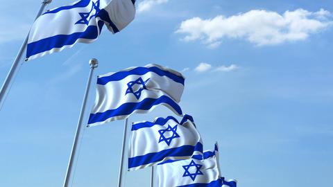 Row of waving flags of Israel agaist blue sky, seamless loop Footage