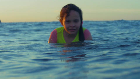 Young girl struggling to swim in ocean Live Action