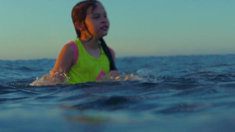 Young girl splashing around in ocean Image