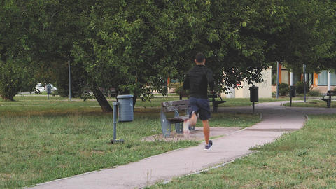 Athletic fitness man running in urban city  Footage