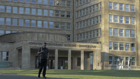 Man walking in front of Goethe University in Frankfurt, Germany Image
