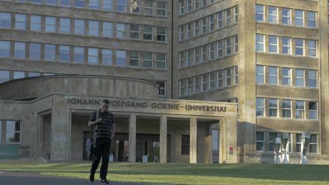 Man walking in front of Goethe University in Frankfurt, Germany Image