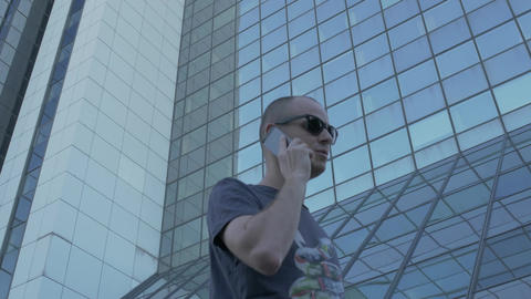 Casual man taking important phone conversation outside Stock Video Footage