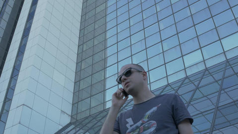 Young man talking business on the phone, negotiating,... Stock Video Footage