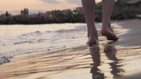 Heartbroken man walking alone in the beach at sunset Footage