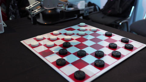 Robot playing checkers. Hand manipulator moves checkers Footage