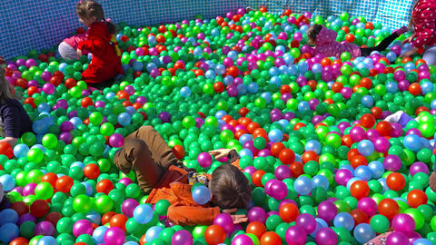 Minsk, Belarus - May 13, 2017: Children playing among colorful plastic balls Image