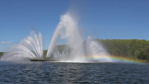 Fountain on the river and rainbow in summer in Minsk. Belarus Image