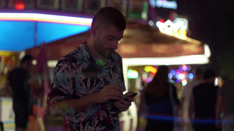 Young man on a smartphone in downtown Las Vegas Footage
