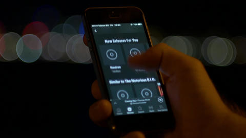 Discovering new music in Spotify mobile app Footage