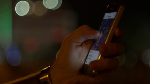 Instagram social network smartphone scrolling at night Live Action