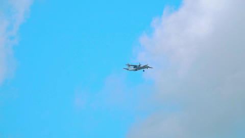 Turboprop airplane flying in the sky. Slow motion telephoto lens shot Footage