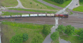 Beautiful summer nature and cargo train, runs through the city. Aerial footage Footage