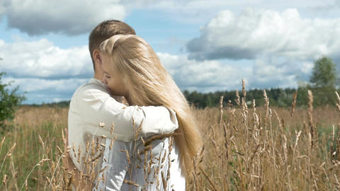 Young couple on date in wheat field Stock Video Footage