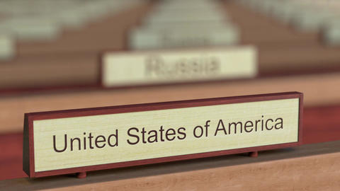 United States of America name sign among different countries plaques at Footage