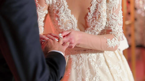 Bride Putting a Wedding Ring On Groom's Finger Live Action