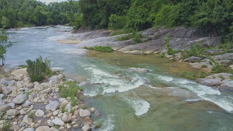 Drone Shows Rocky and Forestry Mountain River Bank Stock Video Footage