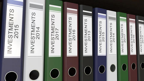 Office binders with Investments tags different years, Live Action