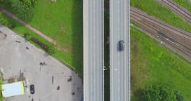 Aerial shot of road among the city with cars and trucks. Summer city landscape Footage